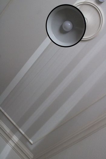 Low angle view of electric lamp on ceiling