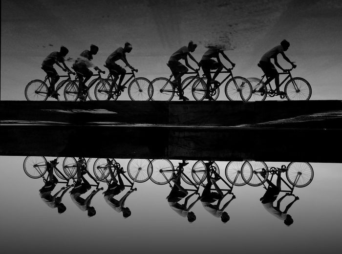 The Bicyclesss Reflection Sportsman Competitive Sport Men Sport Bicycle Competition Sports Clothing Multiple Image Silhouette Cycling Standing Water Puddle Side-view Mirror Symmetry