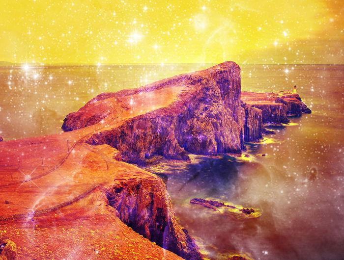 Digital composite of rocks in sea against sky at night