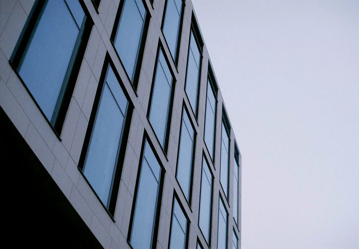 Analog Analogue Photography Architecture Blue Building Exterior Built Structure Clear Sky Copy Space Corporate Business Day Eos50e Fuji C200 Futuristic Low Angle View Mini Minimal Modern No People Outdoors Shape Sky Still The Architect - 2017 EyeEm Awards Tint