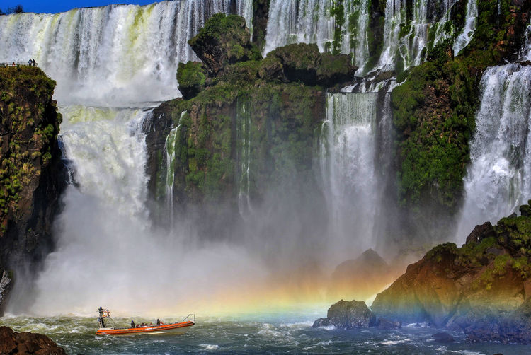 Boating on the Iguassu River, at the foot of the falls, one of the seven wonders of the modern world, in Argentina, South America Boats⛵️ Colors Iguazu 🌈🔆 Iguaçu Nature Power Sunlight The Great Outdoors - 2018 EyeEm Awards Argentina Biggest Fantastic Jungle Landscape Modern Wonders Outdoors Outing Rainbow🌈 River Strength Sun Tourism Travel Destinations Tropical Water Waterfall