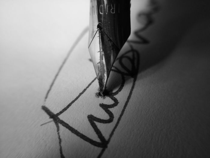 Close-up of pen on paper