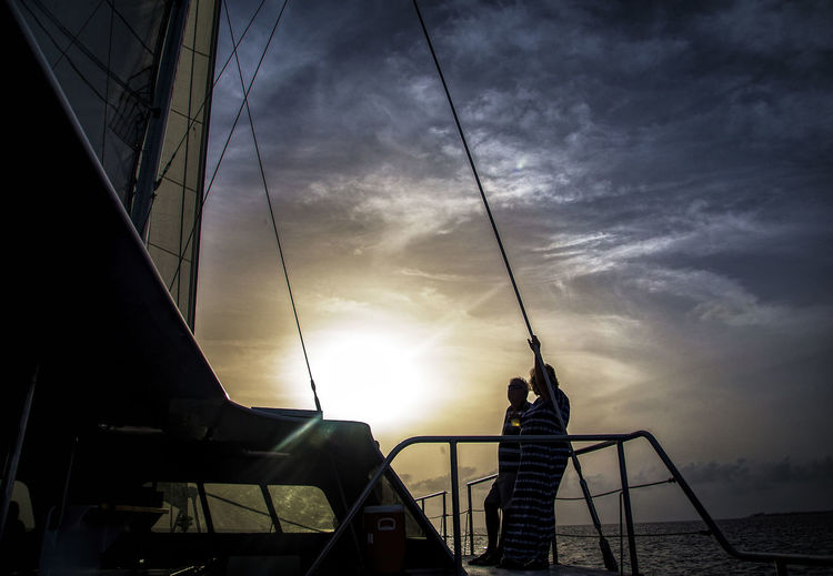 Sunset cruise Caribbean Sea Couple On Deck Cloud - Sky Evening Cruise Leisure Activity Lifestyles Mode Of Transportation Nature Real People Sailboat Sea Silhouette Sky Standing Sunset Sunset Cruise  Transportation Water Yacht