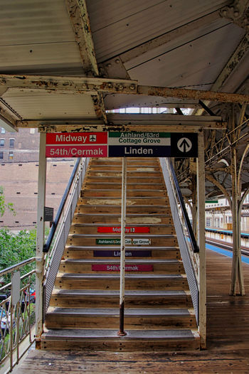 Stairs leading to overpass crossing tracks at a Chicago el station located at Adams/Wabash. Chicago Chicago El Station Chicago El Chicago Loop Elevated Track Sign Stairs Transit Transportation Absence Architecture Arrow Symbol Built Structure Ceiling Colorful Communication Day Direction Empty Guidance Indoors  Information No People Railing Sign Staircase Steps And Staircases Text Transportation Western Script Wood - Material