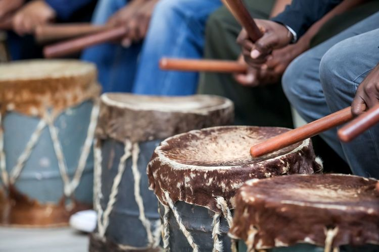 Cropped Hands Of Men Playing Drum