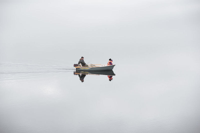 people on boat against sky Copy Space Iceland Iceland Memories Man Water Reflections Woman Beauty In Nature Boat Copy Space Day Fisherman Fisherman Boat Fishermen's Life Iceland Trip Men Mode Of Transportation Motion Nature Nautical Vessel Nordic on the move Outdoors People Real People Sitting Sky Togetherness Transportation Two People Water Waterfront