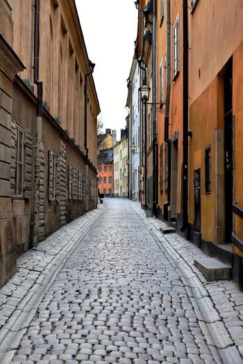 Small alley, Stockholm Brick Road Cute Houses Sweden Stockholm Alley Street Cobblestone Architecture Building Exterior Old Town Residential Building Alley Built Structure City No People Outdoors