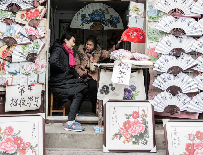 Young couple for sale at market stall