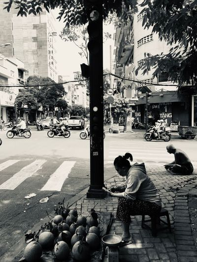 HUMANITY Beggar Street Vendor Streetphotography Silhouette ShotOnIphone Ho Chi Minh City Vietnam City Street Mode Of Transportation Building Exterior Car Transportation Architecture Real People Built Structure Day Group Of People Nature Sidewalk Motor Vehicle Land Vehicle Tree Plant Footpath Road Men