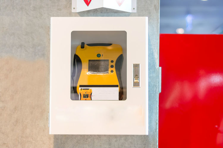 Close-up of yellow telephone on wall