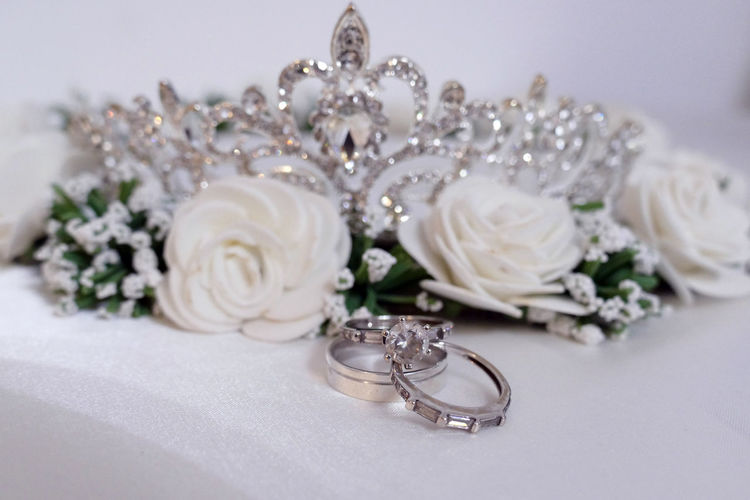 Beautiful Couple Crown Engagement Groom Isolated Love Princess Wedding Bride Celebration Cermony Close-up Diamond Crown Flower Flower Head Indoors  Jwellery Luxury Taira Wedding Wedding Ring White Background White Color White Flower