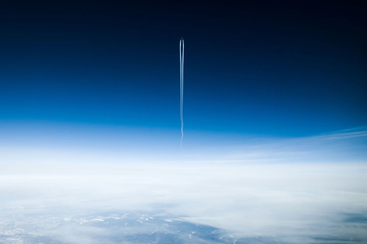 Cloud - Sky Sky Blue Vapor Trail Beauty In Nature Nature Flying Space Scenics - Nature No People Day Air Vehicle Transportation Copy Space Outdoors Mid-air Airplane Motion Aerial View Tranquil Scene