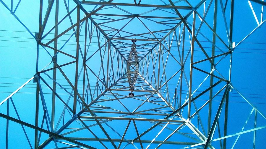 Sky Pattern Cable Technology Blue Metal Clear Sky Power Line  Global Communications Power Supply Electricity  Outdoors Low Angle View Electricity Pylon Iron Steel Nature Strong Model Texture Directly Below Built Structure Complexity Girder Art Work