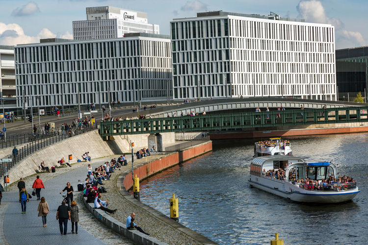 Berlin Photography Adult Architecture Bridge - Man Made Structure Building Exterior Built Structure City City Life Cityscape Day Large Group Of People Men Modern Nautical Vessel Outdoors People Real People Sky Skyscraper Spree River Transportation Travel Destinations Water Discover Berlin