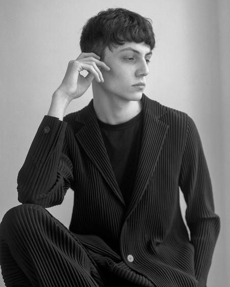 Eugene suited in ISSEY MIYAKE - 2018 One Person Front View Young Adult Young Men Indoors  Waist Up Real People Lifestyles Striped Portrait Leisure Activity Sitting Holding Three Quarter Length Looking Males  Looking Away Contemplation Menswear Hairstyle Film 120mm Filmisnotdead Blackandwhite Suit
