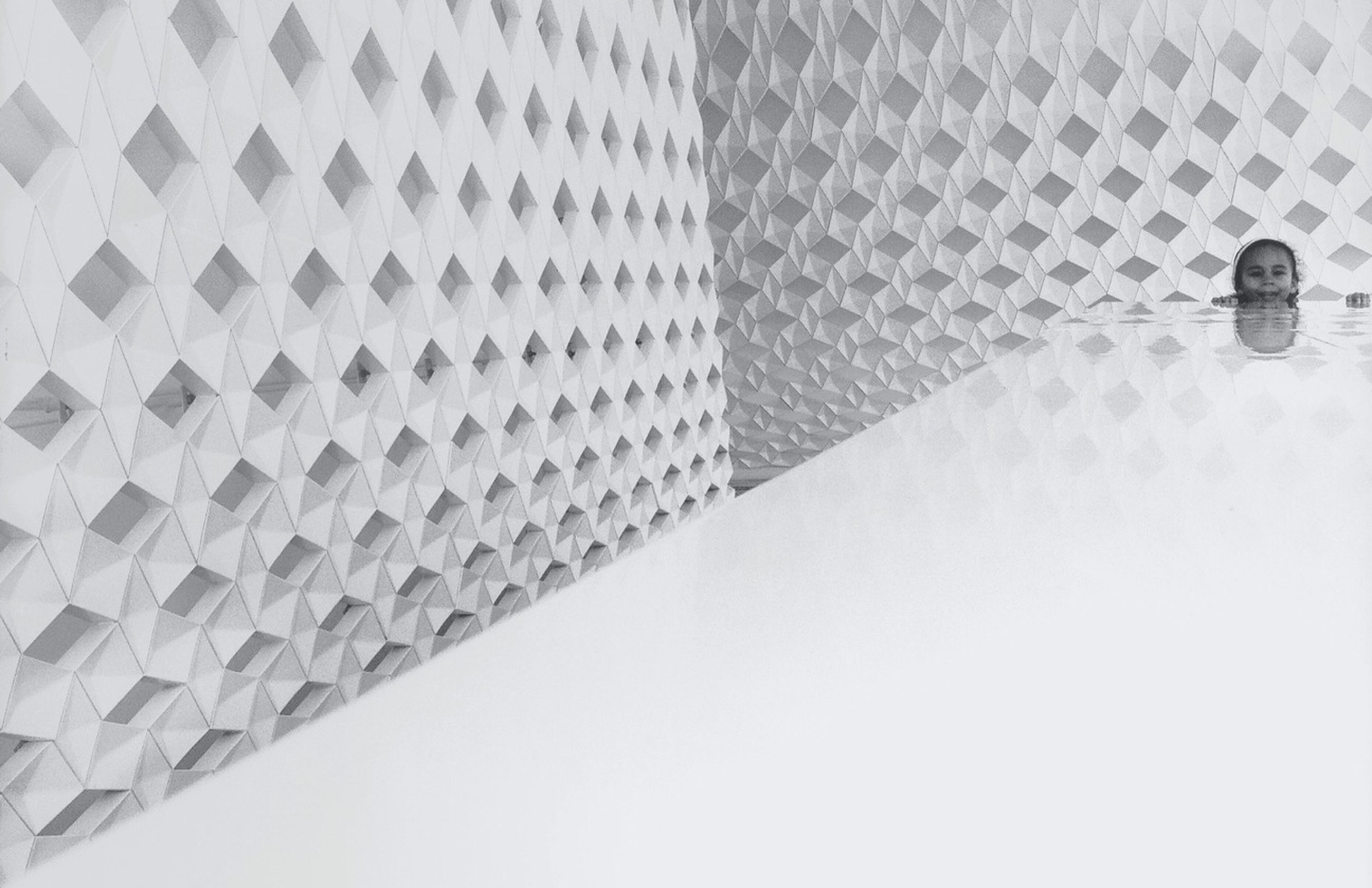 architecture, built structure, building exterior, wall - building feature, pattern, reflection, building, day, shadow, modern, wall, tiled floor, tile, city, high angle view, indoors, window, copy space, flooring