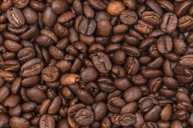 Roasted coffee beans as background Abundance Brown Close-up Coffee - Drink Coffee Bean Food And Drink Freshness Full Frame Group Of Objects Indoors  Mocha No People Raw Coffee Bean Roasted Roasted Coffee Bean Scented