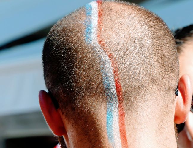 French flag painted on head of man