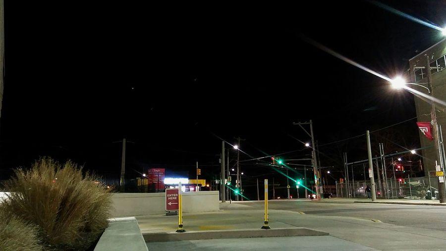 Illuminated street lights at night