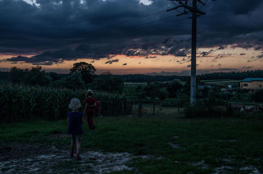Children EyeEm Best Shots Kids Storm Beauty In Nature Childhood Day Dusk Enjoying Life Field Grass Landscape Nature Outdoors People Power Line  Real People Scenics Sky Standing Sunset Togetherness Tree Two People Young Adult