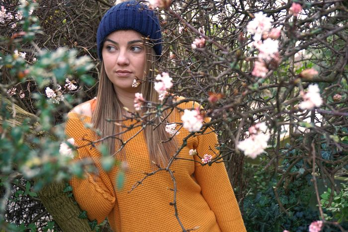 Blossom // Sony a6000 // One Woman Only One Person Flower Beautiful Woman Only Women Beauty Knit Hat Plant Portrait People Adult Outdoors Nature Tree Young Adult Blossom Jumper Brunette Garden Close-up Orange Color Blue Green EyeEmNewHere This Week On Eyeem EyeEmNewHere Uniqueness The Portraitist - 2017 EyeEm Awards