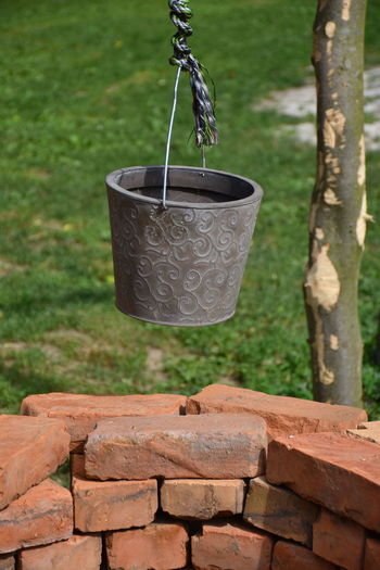 Brick Bucket Focus On Foreground Hanging Metal No People Outdoors Water Watering Can Well