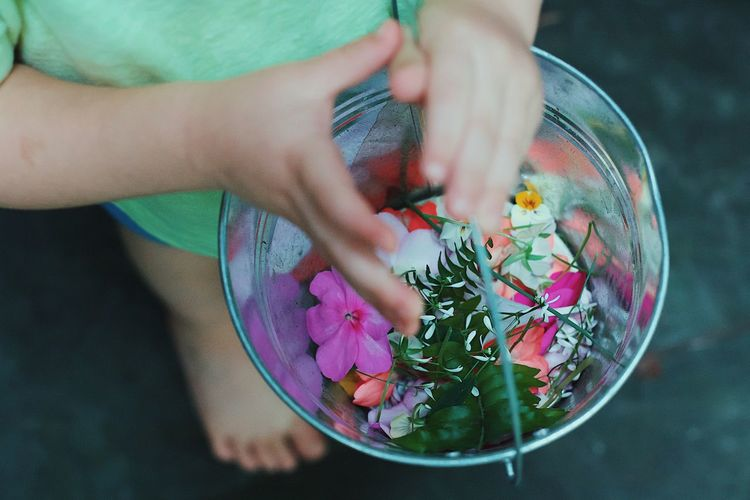 Flowers Bucket Nature Human Hand One Person Real People Human Body Part Childhood Holding High Angle View Child Flower Boy Multi Colored Freshness Day EyeEm EyeEm Best Shots EyeEmBestPics Popular Photos Check This Out Outdoors Photo Photography Photooftheday