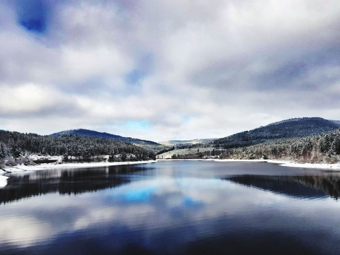 Lake Mountain Reflection Cloud - Sky Snow Tranquil Scene Nature Scenics Landscape Tranquility Water Beauty In Nature Mountain Range Cold Temperature Day Frozen Water Outdoors No People Winter