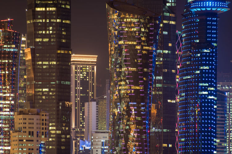 Doha, Qatar Building Exterior City Architecture Built Structure Building Illuminated Night Modern Office Building Exterior Tall - High Skyscraper Cityscape Tower Office No People Financial District  Residential District Downtown District Outdoors Nature Doha Qatar Travel Mid-air