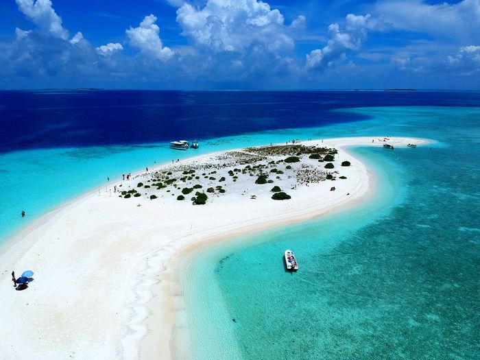 Aerial view of a beautiful white sandbank surrounded by layers of blue water and coral reef in Maldives Maldives Vacation Ocean Blue Water Layer Shallow Deep Sandbank View Crystal Visit Tour Trip Excursion Blue Ocean Clouds White Peaceful Relax Island Inhabited Green Coral Reef Sea Beach Cloud - Sky Sky Sand Water Idyllic Blue Travel Destinations Travel Scenics Beauty In Nature Nature Horizon Over Water Outdoors Summer Vacations No People Day Go Higher