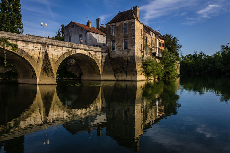 Early morning in Tourness Europe Trip France Tourness Architecture Building Exterior Built Structure Canals And Waterways Day Historic Buildings  Lake Nature No People Old Bridges Outdoors Reflection River Sky Symmetry Tree Water Waterfront