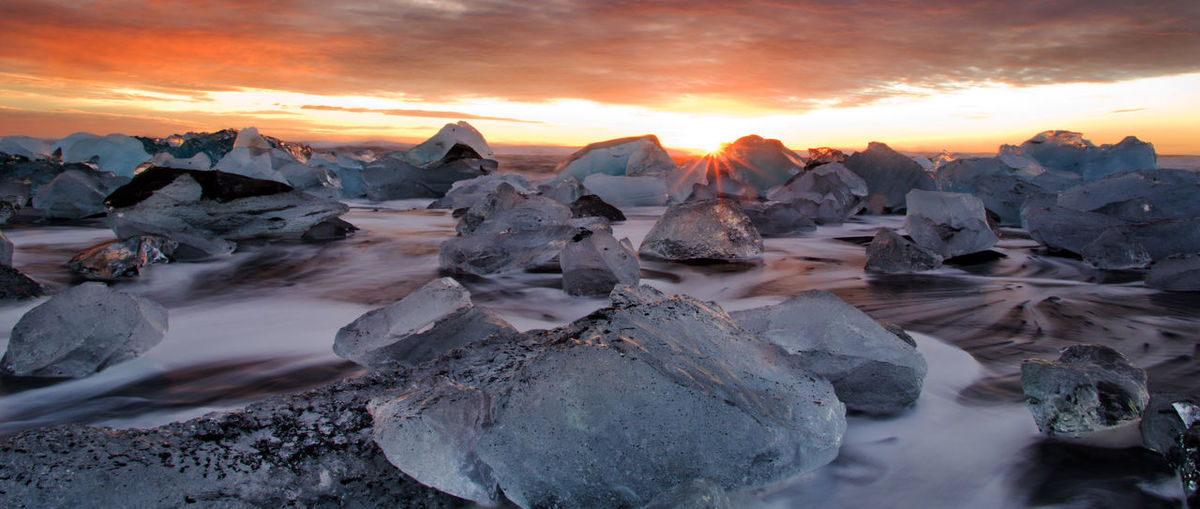 Sky Beauty In Nature Scenics - Nature Water Cloud - Sky Tranquility Tranquil Scene Cold Temperature Nature Solid Orange Color No People Landscape Frozen Ice Outdoors Iceberg Sunrise Diamonds Beach Iceland Waves Ocean Tourist Attraction  Sun Rays