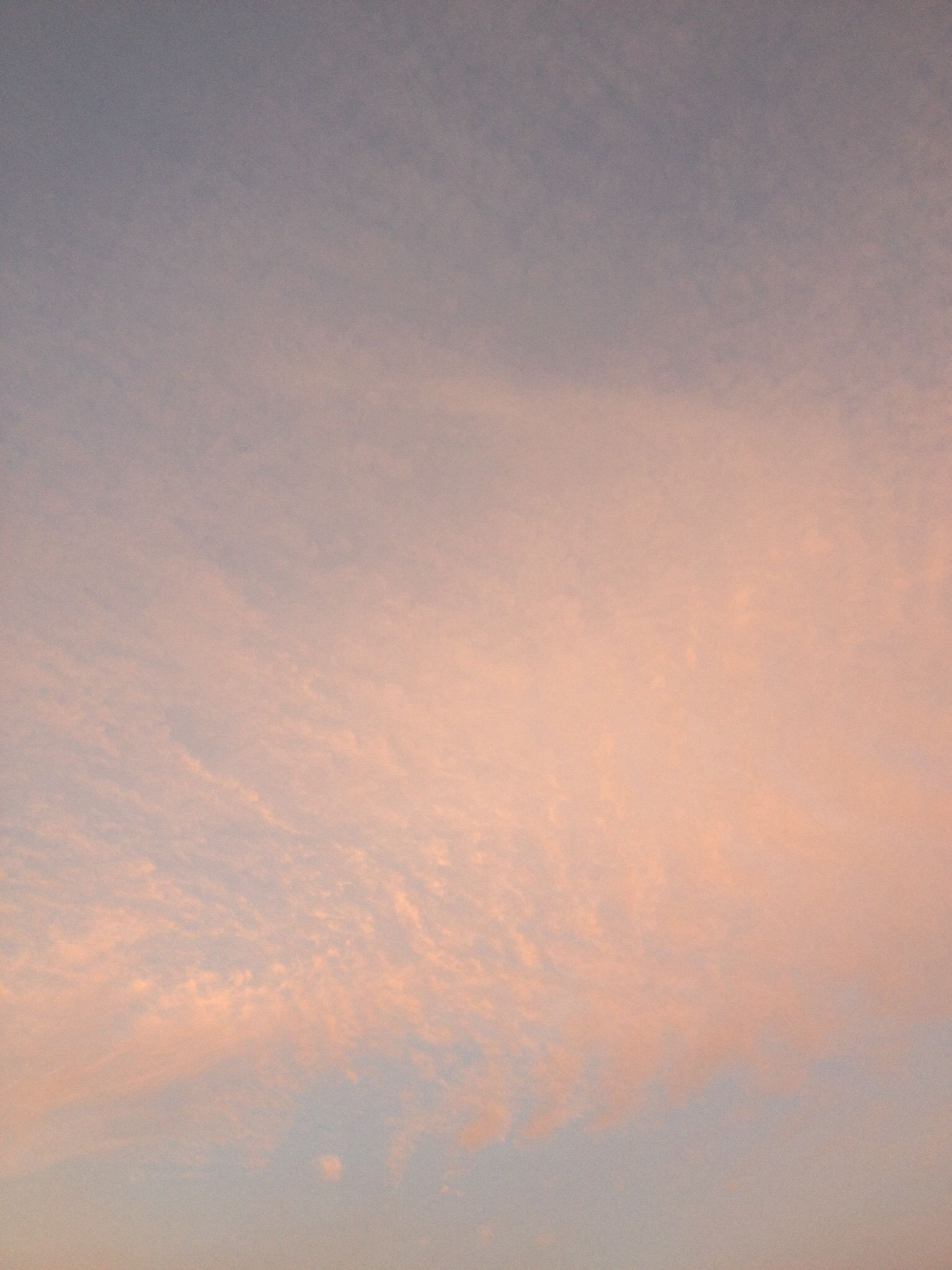 low angle view, sky, beauty in nature, cloud - sky, tranquility, scenics, backgrounds, sunset, nature, tranquil scene, full frame, cloudy, orange color, sky only, idyllic, outdoors, no people, cloud, weather, cloudscape