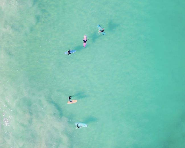 High angle view of people flying over sea