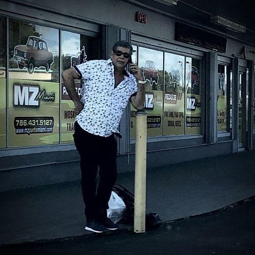 Full length of man standing against door