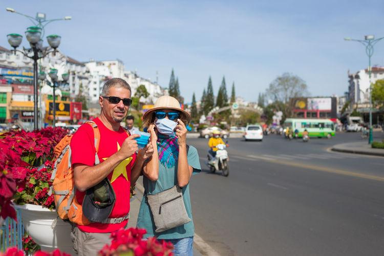 Portrait of friends on street in city