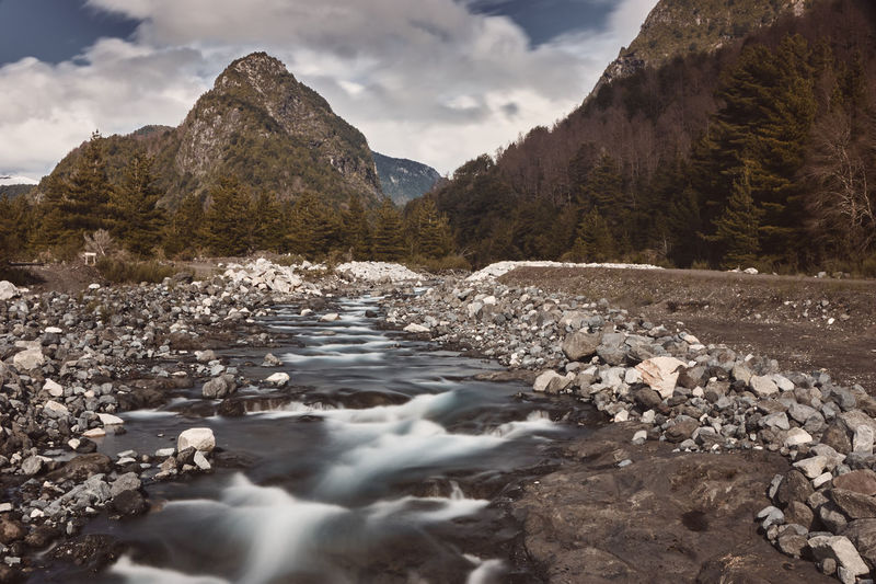 Correntoso River... Beauty In Nature Cloud - Sky Day Environment Flowing Flowing Water Land Mountain Mountain Range Nature No People Outdoors Pebble River Rock Rock - Object Scenics Scenics - Nature Sky Solid Stream - Flowing Water Surface Level Tranquil Scene Tranquility Water