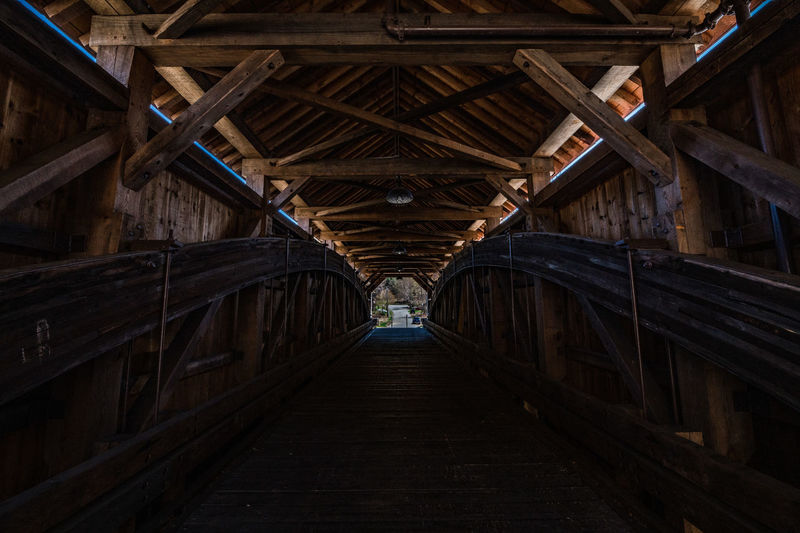 Wood - Material Architecture Built Structure The Way Forward Indoors  Direction No People Diminishing Perspective Day Low Angle View Pattern Connection Empty Transportation Nature Old Ceiling Bridge vanishing point Roof Beam Covered Bridge Over River