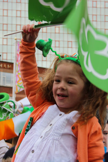 Arms Raised Celebration Celebration Child Childhood Day Fun Girl Green Happiness Happy Kid Maximum Closeness Northern Ireland Outdoors Party Party - Social Event People Portrait Real People Saint Patrick's Day Small Girl Smiling St Patrick's Day Streetphotography
