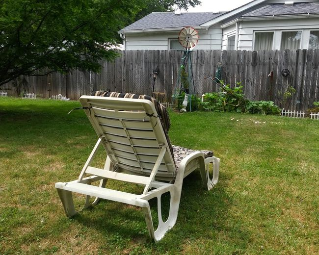 Chairs on lawn in yard