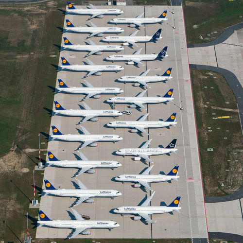 High angle view of airplane flying in a row