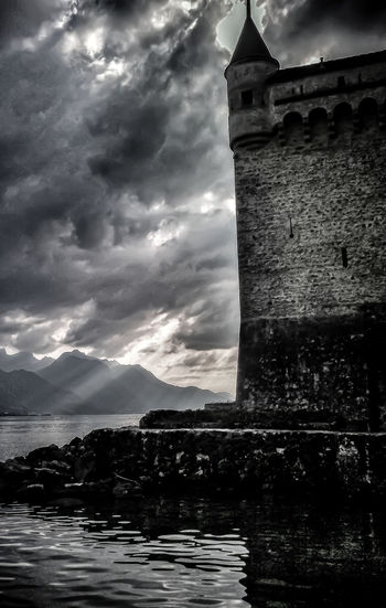 One of European's most fascinating castles welcomes you in Switzerland. More about the history: Blackandwhite Castle Château Clouds And Sky Europe Heritage Historic History Lake Light Monochrome Montreux Photography Switzerland Travel Travel Photography Traveler Travelgram Traveling Veytaux Visit
