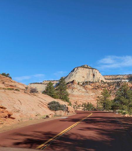 Road In Desert Against Clear Blue Sky