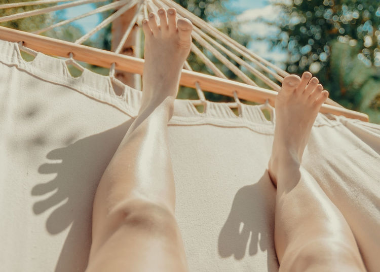 Summer leisure Adult Adults Only Close-up Day Fingers Hammock Human Body Part Human Leg Leisure Activity Low Section One Person Only Women Outdoors People Relaxation Season  Shadow Shadowplay Young Adult County Coumtryside Country Life