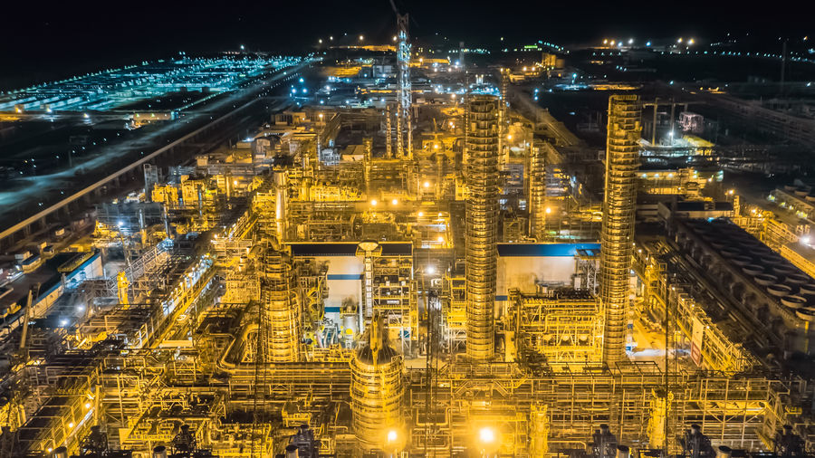 Petrochemical and refinery, industrial landscape view of the plant. Petrochemical Plant Refinery Night Illuminated Architecture Building Exterior City Built Structure Cityscape No People Building High Angle View Outdoors Glowing Nature Fuel And Power Generation Modern Development City Life Office Building Exterior Connection Skyscraper