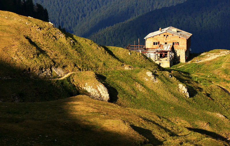 High angle view of chalet on green mountain at bucegi natural park