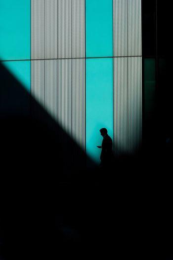 Silhouette businessman standing in dark building