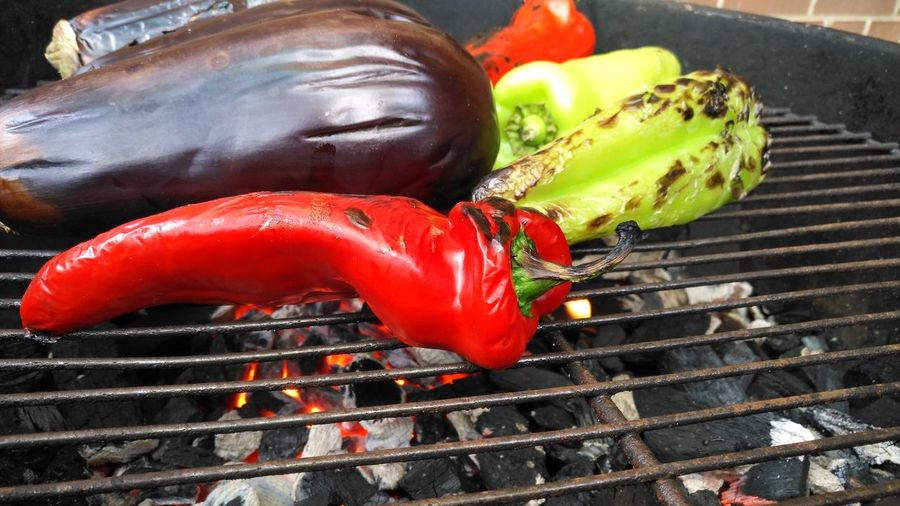 Red chili pepper and eggplant on barbecue grill
