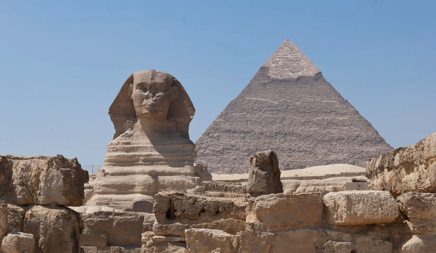 Sphinx and pyramid of khafre against blue sky