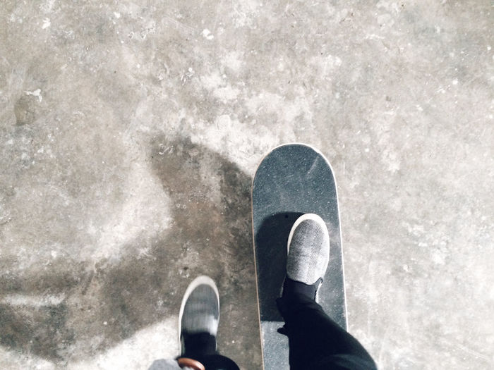 Carefree Footwear Fun High Angle View Hobbies Human Body Part Human Leg Lifestyles Low Section Part Of Personal Perspective Real People Recreational Pursuit Shoe Skateboard Standing Street Weekend Activities